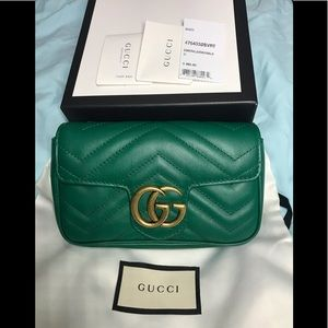 Authentic Gucci mini green and gold hardware.